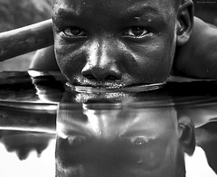 mirror of the soul (Moreno Pregno Photography) Tags: kids white baby beautiful citezens childhood love black magic bokeh life labor quicksand work jesus light face df salgado street suffering shadow africa art danger wildlife world war power reportage reallife true intense eyes nature line portrait contact hospital people blood diamond blackwhite