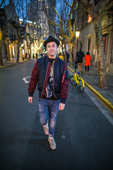 Young man walking on the street (HIKARU Pan) Tags: night photography portrait shanghai chinese china asia xintiandi fashion youngman outdoors light 24l canonef24mmf14liiusm 1dx eos1dx walking smiling