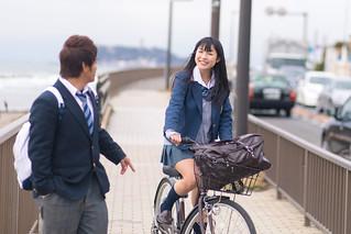 High school girl meets boyfriend on the way to school