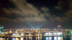 Light burst (Roving I) Tags: spotlights sky clouds nightlife hanriver cities cityscapes promotions danang vietnam reflections
