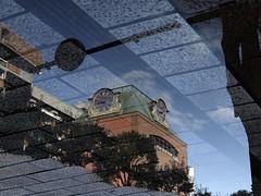 Reflecting world ! (FujiFilm XF1) (potopoto53age) Tags: reflection world puddle reflectingworld clocktower clock tower building brick sidewalk tile fujifilmxf1 fujifilm xf1 fujinon25100mmf1849 fujinon 25~100mm f18~49 appleaperture apple aperture potopoto53age