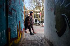 Passing graffiti @ Utrecht (PaulHoo) Tags: utrecht holland netherlands people streetcandid street candid streetphotography 2017 urban citylife art streetart graffiti color elderly oude gracht