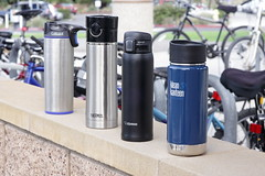 travel coffee mugs lined up on concrete (yourbestdigs) Tags: water bottle travel mug coffee thermos hot drink drinks beverage bottles mugs office leak stainless steel insulated warm liquid food lid lids tea hydration morning breakfast drinking exercising
