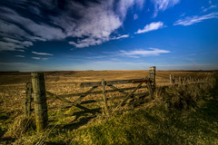 """rustic farm gate at Winnyfold, coastal farmland, deep blue sky, spring in Aberdeenshire, Scotland (grumpybaldprof) Tags: aberdeenshire scotland uk eastcoastcolours gare farm grass sun sunshine bright afternoon spring hdr clouds glorious cliffs farmgate barbedwire hill hillside fence stubble shadow vlouds whiteclouds atmosphere peaceful sigma 1020 1020mm f456 """"sigma1020mmf456dchsm"""" landscape countryside detail decay canon canon7d collieston winnyfold wooden neutraldensity filter longexposure"""