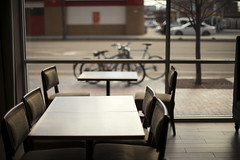 Chairs and Tables (Curtis Gregory Perry) Tags: boise idaho chair table hotel hampton inn window bike bicycle nikon d810 50mm f12