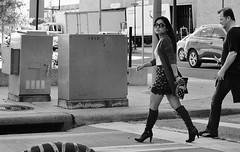 Look Back (burnt dirt) Tags: houston texas downtown city town mainstreet street sidewalk streetphotography fujifilm xt1 bw blackandwhite girl woman people person asian boots heels kneehigh leather skirt glasses sunglasses bag purse longhair man couple pair crosswalk walking