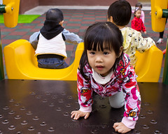 Playground Promotions 05 (C & R Driver-Burgess) Tags: infant preschool toddler child kids girl boy pink red green climb slide swing throw ball playground plastic jackets tights skirt jumper top reach squat play together