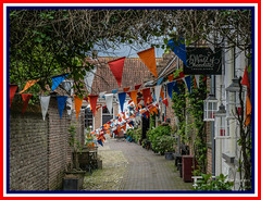 King's Day (Peter Jaspers (on/off)) Tags: frompeterj© 2017 olympus zuiko mft m43 omd em10 1240mm28 koningsdag kingsday buren gelderland tricolor driekleur vlag flag postcard