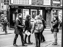 A friendly greeting. (steve.gombocz) Tags: urbanstreet blacknwhite greyscale streetscene blackwhite bwphotos bwstreetscenes bw bwstreet flickrbw bwflickr blackwhitephotos blackwhitephotography flickrstreet streetlife street blackandwhite blackwhitestreet bwstreetphotography streetphotographs bwphotographs streetphotography bwphotography photosinblackabdwhite bwpictures flickraddicts flickraddict blackandwhitephotographs purestreet out outandabout streetpictures streetphotos flickr exploreflickr smile greeting group york flickryork exploreyork yorkbw yorkblackandwhite yorkscenes people zwartwit neroebianco sortoghvid mustavalkoinen svarthvitt svartoghvitt pretoebranco noiretblanc schwarzundweiss negroyblanco noirblanc schwarzweiss negroblanco pretobranco nerobianco olympus olympususers olympusamateurs olympuseurope olympuszuikodigitalclub olympusm25mmf18 olympuszuikodigital olympusem5mark2 olympusomd