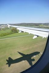 A321 aircraft shadow flying (roli_b) Tags: airbus a321 aircraft airplane jet flugzeug flieger avion aereo aviacao plane shadow schatten fliegen april 2016 swiss hbiom window seat wing fenster fensterplatz flügel switzerland suisse suiza svizzera schweiz zrh zurich landing approaching approach