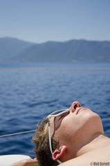 Sunbathing (Matt Gorvett Photography) Tags: travel sea sun holiday mountains sunglasses relax boat nikon sailing relaxing dslr sunbathing ioniansea ionian 18105mm d5100 nikond5100
