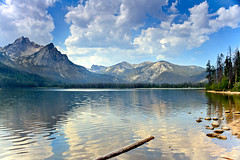 Golden Reflections On Stanley  Lake (http://fineartamerica.com/profiles/robert-bales.ht) Tags: blue usa lake mountains reflection nature water beauty yellow horizontal clouds reflections landscape outdoors golden photo emotion awesome fineart scenic surreal environmental peaceful panoramic hike idaho nationalforest evergreen alpine stanley environment rockymountains feeling wilderness inspirational spiritual sublime drama magical tranquil magnificent inspiring haybales pristine dramtic sawtoothmountains custercounty canonshooter mcgownpeak robertbales stanleyarea