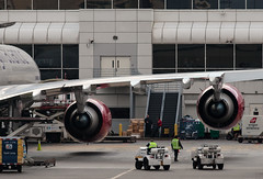 Massive engines hanging like red Christmas tree ornaments