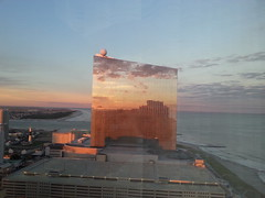 sun sets on the Revel (Eric.Ray) Tags: samsunggalaxycellphoneandroidoutdoors casino revel closed bankrupt sunset reflection gamble