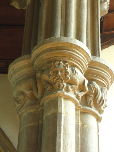 14th-century capital - grotesque heads and a dragon