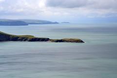 Seascape (edward.butleredb) Tags: blue light sea seascape wales clouds landscape bay coast aqua sunny peninsula cardigan torquoise