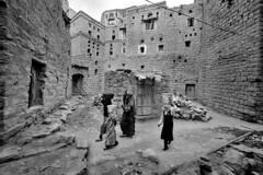 Yemen - Hababa (luca marella) Tags: street people bw white black film water stone analog blackwhite women voigtlander bessa middleeast social pb bn bianco nero bearer marellaluca