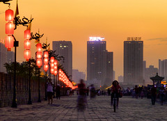 Equilibrium [explored] (CiccioNutella) Tags: china old city light sunset people bike buildings ancient xian walls lantern