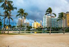 The Lagoon and Hotel (telazac) Tags: ocean trees sky nature water weather clouds sunrise canon hawaii unitedstates waikiki palm palmtrees honolulu alawai hiltonhawaiianvillage ilikai t5i