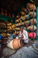 Drum Maker (Harshal Orawala) Tags: india drum maker 121clicks vrindavan indian light colours wide framing story