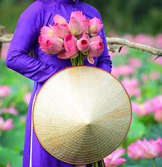 Asian woman in traditional dress with lotus flower (phuong.sg@gmail.com) Tags: aodai asia asian beautiful beauty blue bouquet bud bunch culture cute desert dress female flower girl holding indochina lotus material model naive obesum orchid outdoor people pink pool portrait purity purple rose silk smile smiling tradition traditional vietnam vietnamese violet water wearing wet woman women