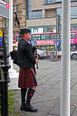 Bagpiper in Edinburgh centre close to Waverley Station Scotland (travelmag.com) Tags: edinburgh scotland royalmile travel brittania bagpiper music