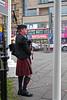 Bagpiper in Edinburgh centre close to Waverley Station Scotland (travelmag.com) Tags: edinburgh scotland royalmile travel brittania bagpiper music