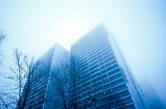 Blue Berlin. (wojszyca) Tags: contax g2 zeiss biogon 21mm fuji fujichrome t64 rtp tungsten slide blue sky fog haze berlin city urban architecture socialist modernism highrise housing towerblock