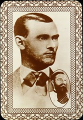 Old West Collectors Series Postcard: Texas Outlaw Jesse James with an inset death photo.  Published by Kustom Quality (1970s) (lhboudreau) Tags: beard mustache monochrome americanwest western westerns legends legend legendary outlaw jessejames bandit robber oldwest postcard postcards vintagepostcard 1970 oldwestcollectorsseries kustomquality people portrait
