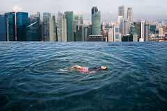Asian girl swimimg in the roof top swimming pool in Hotel (anekphoto) Tags: pool singapore swimming marina sands city infinity luxury bay hotel view beautiful malaysia roof skyline top people travel sky kuala lumpur vacation tourist lifestyle water tourism relax landmark skyscraper business modern asia cityscape architecture scene woman beauty landscape attraction outdoors building urban high tall rooftop resort asian outdoor summer girl