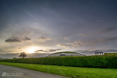Newgrange sunset halo (mythicalireland) Tags: sunset setting sun newgrange evening halo 22degree cirrus clouds refraction rainbow light monument boyne valley meath ireland landscape