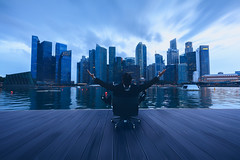 Successful businessman (Patrick Foto ;)) Tags: adult aec arms asian back background building business businessman career celebrating chair city cityscape concept copyspace excited executive freedom future happy idea job joy leader leadership looking male man manager modern office outdoor people person professional silhouette singapore sitting sky skyline skyscraper success successful suit urban victory view work young