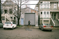 1069 (Super G) Tags: oly2017181 sanfrancisco california unitedstates film olympusom4 zuiko28mmf28 fujicolor200 streetphotography victorian garage door man walking car