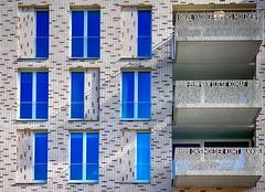 balkons met een verhaal . (roberke) Tags: building ramen vensters windows balkon text tekst architecture architectuur modern uden netherlands nederland outdoor zon sun balcony