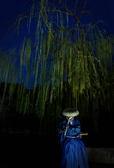 Piper Under the Tree (Pai Shih) Tags: kyoto man willow tree people pipe flute piper 京都 willowtree japan 日本