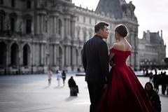 A Married Couple in Paris (Gwenaël Piaser) Tags: paris april 2017 avril april2017 france mariés wedding louvvre spouses red rouge robe dress museum outdoor musée muséedulouvre 85mm 85mmf18 canonef85mmf18usm ef85mmf18usm ef85mm usm ef85mmusm canonef85mm118usm prime parigi francia îledefrance unlimitedphotos gwenaelpiaser canon eos 6d canoneos eos6d canoneos6d fullframe 24x36 reflex rawtherapee bokeh woman femme homme man married couple marriedcouple street rue contrejour backlight backlit louvre 1000