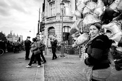 woman with balloons (ElBiSt (Bianca Stoicheci)) Tags: woman balloons people peoplephotography blackandwhite bw blackandwhitestreetphotography antwerpen antwerpenstad fujifilm
