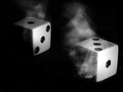 Dice in motion (pierrednepr) Tags: macromondays intentionalblur black white dice inmotion olympus macro