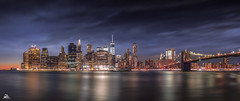 Manhattan Skyline by Night (Domi Art Photography) Tags: newyork ny nyc manhattan usa night bridge brooklyn sea ocean mer seascape landscape cityscape scape building buildings wtc worldtradecenter one libertytower sky clouds longexposure poselongue reflection reflet reflect canon panoramic panoramique skyline autofocus
