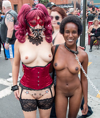 Submissive by malecution - This girl seemed delighted to be led around completely naked in public by a leashed collar - and also very happy to pose with another woman showing off her tits and pussy at the Folsom Street Fair.
