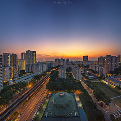 Heartlands (rh89) Tags: city blue sunset urban panorama public architecture night train square twilight singapore track cityscape angle pano sony transport wide tracks mosque panoramic heartland hour crop transit housing format mrt 1018 sel hdb clementi heartlands a7r 1018mm