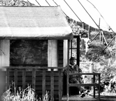 Sitting on the porch (adam_moralee) Tags: old portrait bw white lake man black male hat by lens countryside blackwhite fishing nikon sitting shot shed relaxing wb hut mature porch hip tamron wrinkles wrinkle hipshot 18200mm d3100 adammoralee