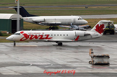 Bombardier CRJ-200ER C-GJZZ Air Canada (Jazz) (EI-DTG) Tags: canada vancouver britishcolumbia jazz yvr f28 fellowship crj aircanada planespotting crj200 vancouverinternational aircraftspotting fokkerf28 cgjzz cfcrz firetrainer 27jun2014