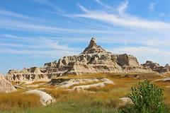 Badlands National Park, South Dakota (Geraldine Curtis) Tags: blue sky grass rock southdakota badlandsnationalpark outcrops