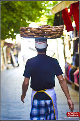 Turkish street food bread seller (enam choudhury) Tags: street summer portrait food hot canon turkey print bread outside outdoors photography prime photo raw photographer graphic busy dslr turkish