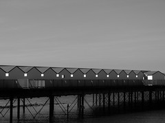 Village on the Pier (Compactman) Tags: sea blackandwhite bw beach lumix pier kent seaside village panasonic hernebay thanet northkent fz100