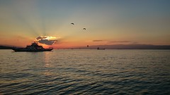 Sunrise over the sea (by mobile) (Oras Al-Kubaisi) Tags: sea sky cloud sun mobile clouds sunrise clear part partly