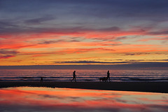 At the end of the day... (John Ibbotson (catching up!)) Tags: ocean sunset sea sun colour reflection beach water silhouette wales clouds coast coastal ceredigion borth