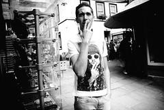 Kurt Vs Kurt (walkdontthink) Tags: street people urban bw white black streets southwest monochrome silhouette contrast bristol photography nikon kurt nirvana candid streetphotography smoking j1 compact kurtcobain cornstreet nikon1 stnicksmarket