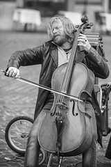 Ace of Base - Street Performer in action (hkokko) Tags: italy pantheon people portrait rome street streetphotography bass bassplayer blackwhite canon5dmarkiv environmentalportrait leathercoat longhair musician player string travel